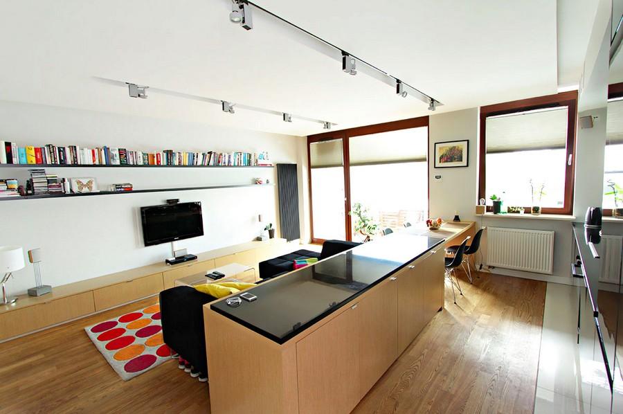 A ilha da cozinha separa as salas